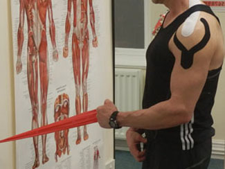 Kineso tape with theraband therapy